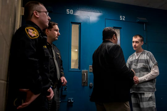 Jim Lindsey, 27, talks to Don Evans, supervisor for inmate programs at the Hamilton County Justice Center following a press conference on Thursday in the newly opened men's recovery pod.