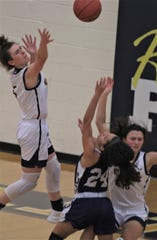 Notre Dame sophomore Macie Feldman tries to block the shot of Campbell County senior Jalyn Jackson as Notre Dame defeated Campbell County 52-41 in girls basketball Feb. 5, 2020 at Notre Dame Academy, Park Hills, Ky.