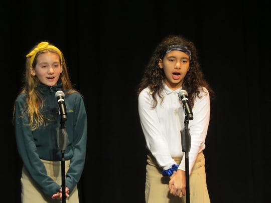 """Deanna Nicholls of Dunellen and Carly Jones of Scotch Plains perform a vocal duet to """"Riptide"""" at the Lower School Cabaret."""
