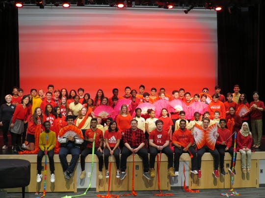 Students gather for a group photo after performing a series of dances.