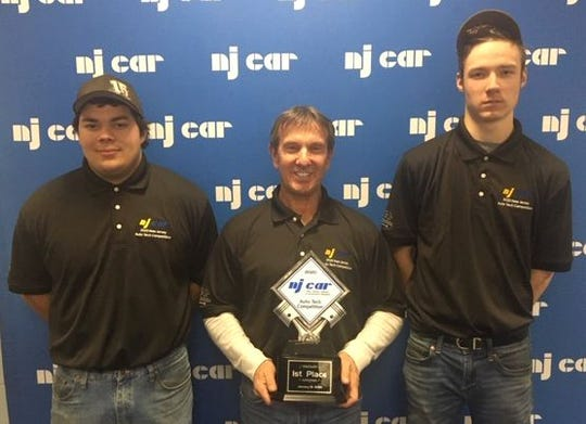 (Left to right): From Hunterdon County Polytech Career and Technical High School are Geordan Marrero, Automotive Technology Instructor Chris Scheuerman, and Stephen Koehler with the first-place trophy at the New Jersey Auto Tech Competition held last month.