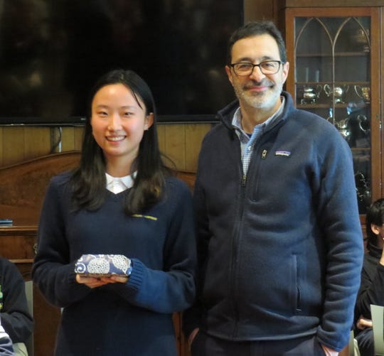 Shakespeare recitation winner Lisa Li of Colonia receives first prize from W+H Humanities Department Chair Richard Fulco of Montclair.