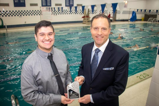 Eddie Norgard (left) receiving a 30 Under 30 honor from YMCA of the USA. On the right is Greater Somerset County YMCA CEO David Carcieri.