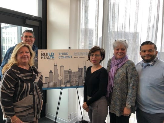 (Left to right)Marge Drozd, of Saint Peter's University Hospital; John Dowd, of the Middlesex County Office of Health Services; Ana Bonilla, program coordinator of the New Brunswick Healthy Housing Collaborative; Mariam Merced, of Robert Wood Johnson University Hospital; and Manuel Castaneda, of New Brunswick Tomorrow.