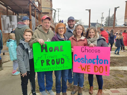 Residents made signs and gathered at the artPARK  Saturday morning to take part in a video which was submitted to the HGTV Hometown Takeover contest.