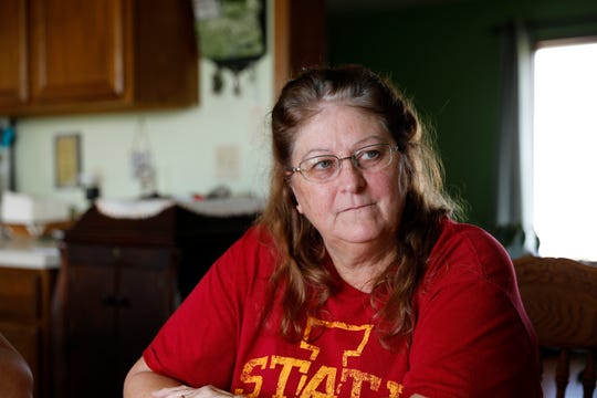 In this Oct. 29, 2018, photo, Gail Schwartzkopf, of Rudd, Iowa, talks about the concentrated animal feeding operation, or CAFO, built near her home in Rudd, Iowa. Jeff and Gail Schwartzkopf say their lives changed drastically after a hog operation was built a quarter-mile from their home in northern Iowa.