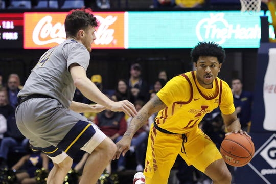 Iowa State guard Prentiss Nixon (11) drives up court as he is defended by West Virginia guard Chase Harler (14) during the first half of an NCAA college basketball game Wednesday, Feb. 5, 2020, in Morgantown, W.Va. (AP Photo/Kathleen Batten)