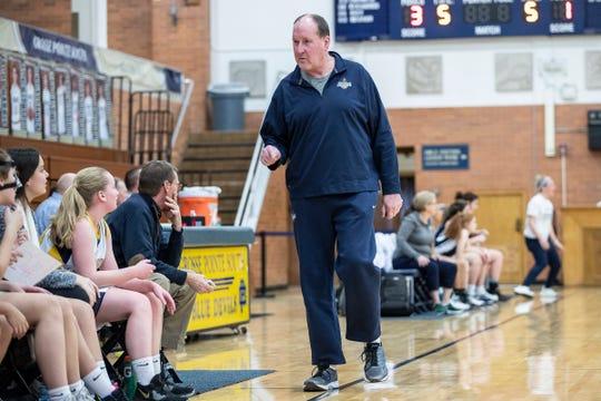 Grosse Pointe South High School girls' freshman team coach Bob Zaranek talks to players during a game against Macomb Dakota at Grosse Pointe South on Tuesday, Feb. 4, 2020.