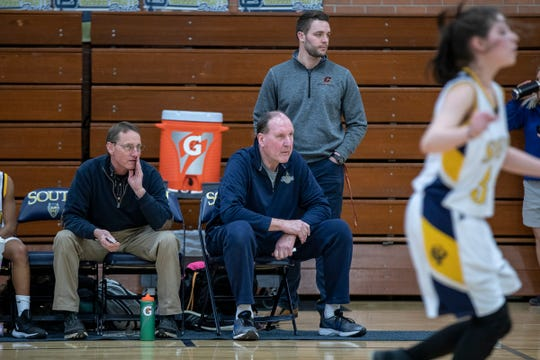 Grosse Pointe South High School girls' freshman team coach Bob Zaranek sits next to athletic trainer Collin Karcher, left, during a game against Macomb Dakota at Grosse Pointe South High School in Grosse Pointe Farms, Tuesday, Feb. 4, 2020.