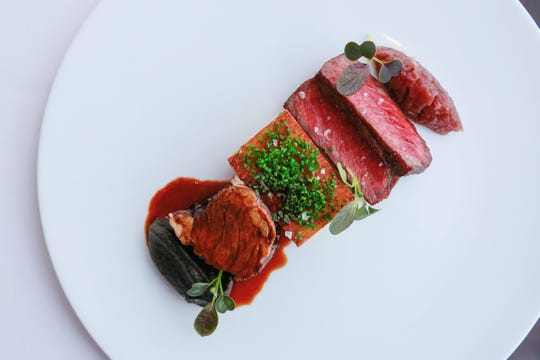 Iowa wagyu beef with potato mille-feuille, braised short rib and charred onion from Pernoi in Birmingham.