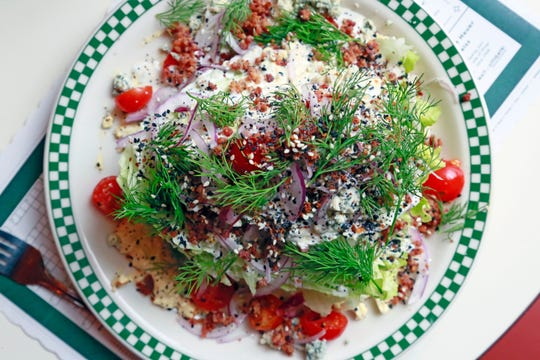 """The wedge salad from Karl's in Detroit is a classic rendition with the embellishment of """"everything bagel"""" spice and fresh dill."""