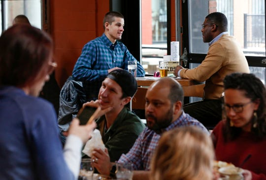 (L to R) Will Korn, 27 of Lansing and Clarence Gayles, 46 of Detroit talk during a lunch at Founders Brewing Co. Gayles who works for Thomas Group Consulting was hired by Founders for diversity and inclusion program that they are implementing.The taproom reopened at 11 am on Thursday, February 6, 2020 after being closed for more than 3 months because of a racial discrimination lawsuit.