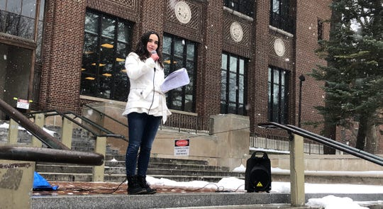 Emma Sandberg, 19-year-old student at U-M and organizer of the event, called on the university to alter its sexual misconduct policies in front of a group of protesters at the Diag Feb. 1 following the news of sexual misconduct allegations against Provost Martin Philbert.