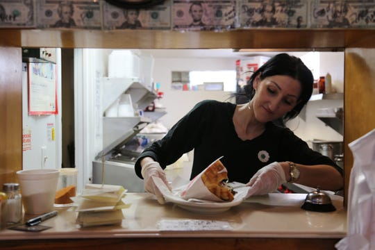 Balkan House owner Juma Ekic plates an order of doner kebab. Her Hamtramck restaurant is the only place in metro Detroit that serves a German-style doner.