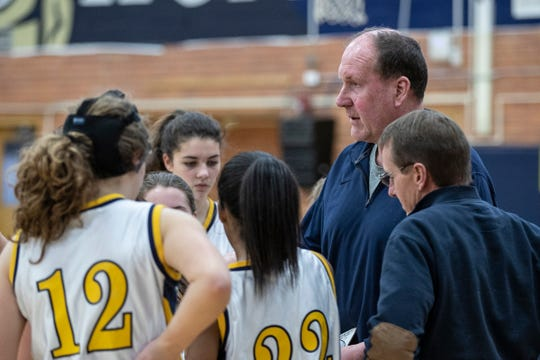 Grosse Pointe South High School girls' freshman team coach Bob Zaranek talks to players at a timeout during a game against Macomb Dakota at Grosse Pointe South High School in Grosse Pointe Farms, Tuesday, Feb. 4, 2020.