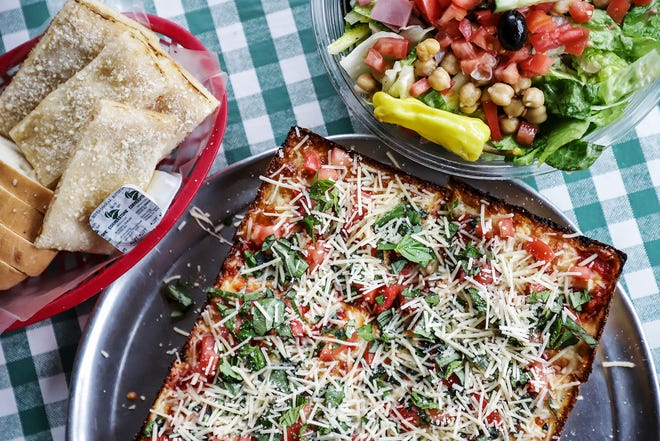 A bruschetta pizza, antipasto salad and crispy bread are some of the food served at Cloverleaf Bar and Restaurant in Eastpointe, Mich. photographed on Wednesday, Feb. 5, 2020.