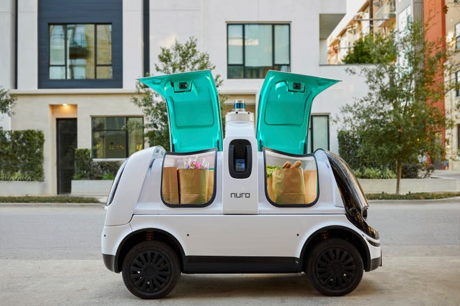 "This undated image provided by Nuro in February 2020 shows their self-driving vehicle ""R2"" carrying bags of groceries. On Thursday, Feb. 6, 2020, the U.S. National Highway Traffic Safety Administration granted temporary approval for Silicon Valley robotics company Nuro to the a low-speed autonomous delivery vehicle, without side and rear-view mirrors and other safety provisions required of vehicles driven by humans."