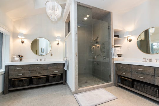 Like all 5 1/2 baths, this one in the master suit is completely remodeled in contemporary style. It has two vanity sinks and a steam shower. Photographed in Independence Township, Tuesday, Feb. 4, 2020.