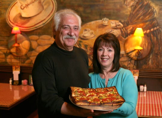 Owners, Jack Guerra and Marie Guerra Easterby with one of their Detroit Style pizzas at their restaurant, Cloverleaf Pizza in Eastpointe,Tuesday May 26, 2009. SUSAN TUSA/Detroit Free Press