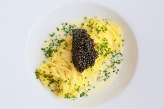 Saffron capellini in mascarpone fumet topped with Ossetra caviar from Pernoi in Birmingham.