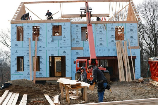 In this Jan. 4, 2019, file work continues on a plan of new homes in Franklin Park, Pa.  U.S. productivity rebounded in the final three months of 2019, helping to boost productivity growth for the year to the best showing in nearly a decade.