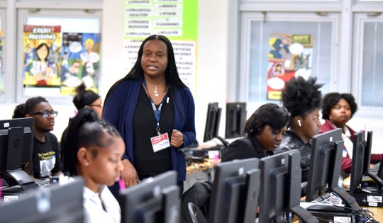 Accounting Aid Society Program Manager Garylle Smith, of Southfield, walks between students as she announces test instructions.