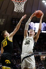 Purdue center Matt Haarms (32) shoots over Iowa guard Joe Wieskamp (10) during the second half Wednesday. Purdue defeated Iowa 104-68.