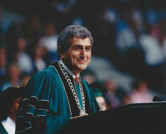John DiBiaggio, Michigan State University's 17th president, speaks at a commencement ceremony in 1992.