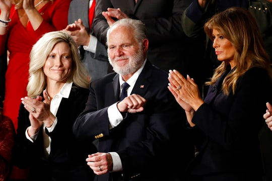 Rush Limbaugh reacts as first Lady Melania Trump, and his wife Kathryn, applaud, as President Donald Trump delivers his State of the Union address to a joint session of Congress on Capitol Hill in Washington, Tuesday, Feb. 4, 2020.