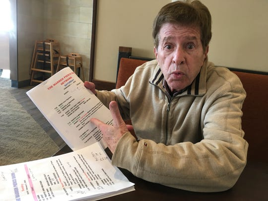 Across two lengthy stints, Warren Pierce spent 37 years at WJR-AM (760). Now he's buying weekend morning airtime at WDFN-AM (1130), hoping to turn a profit by selling ads. Here, he goes over notes for an upcoming show.
