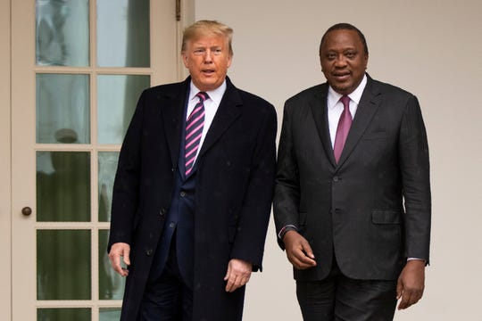 President Donald Trump and Kenyan President Uhuru Kenyatta stand together at the White House, Thursday, Feb. 6, 2020, in Washington.