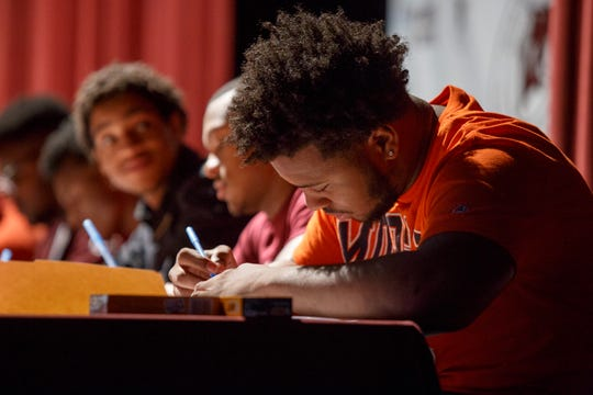 De'Andre Bulley signs his letter of intent to play at Morgan State on Wednesday.