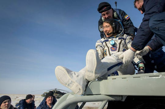 NASA astronaut Christina Koch is helped out of the Soyuz MS-13 spacecraft Thursday just minutes after she, Roscosmos cosmonaut Alexander Skvortsov, and ESA astronaut Luca Parmitano, landed their Soyuz MS-13 capsule in a remote area in Kazakhstan. Koch returned to Earth after logging 328 days in space, the longest spaceflight in history by a woman.