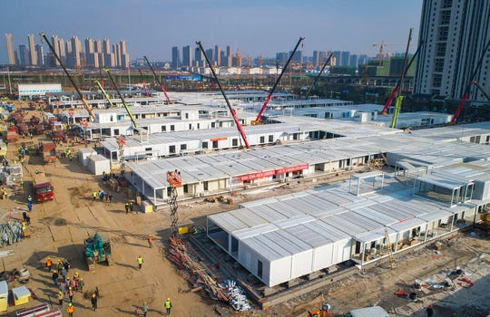 In this Feb. 4, 2020, photo released by China's Xinhua News Agency, construction workers labor at the Leishenshan Hospital, the second temporary field hospital being built in Wuhan in central China's Hubei Province.