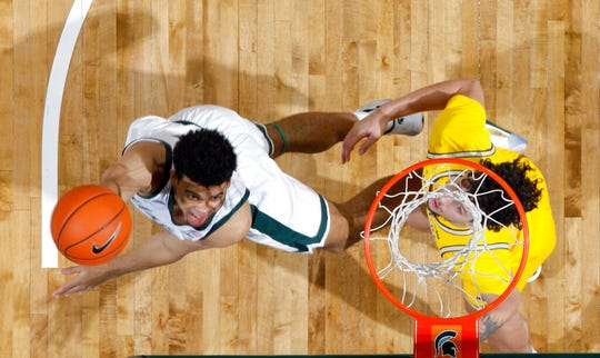 Michigan State's Malik Hall, left, shoots against Michigan's Brandon Johns Jr. during the first half the Spartans' 87-69 victory in January at the Breslin Center in East Lansing.