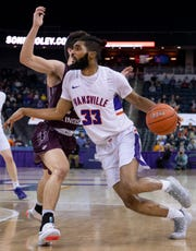 Evansville's K.J. Riley (33) drives against Southern Illinois during their game at Ford Center Wednesday night, Feb. 5, 2020.