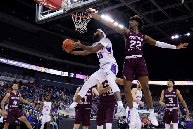 Evansville's John Hall (35) shoots a reverse layup against Southern Illinois' Harwin Francois (22) during their game at Ford Center Wednesday night, Feb. 5, 2020.