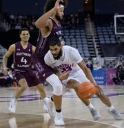 Southern Illinois' Barret Benson (40) defends Evansville's K.J. Riley (33) during their game at Ford Center Wednesday night, Feb. 5, 2020.