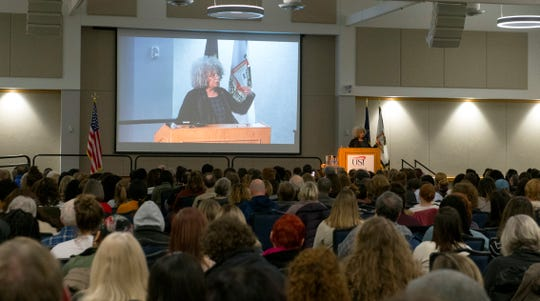 Students and community members fill Carter Hall at the University of Southern Indiana to listen to activist Dr. Angela Davis delivery her keynote address during USI's Mandela Social Justice Day event Wednesday evening, Feb. 5, 2020.
