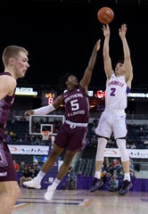Evansville's Artur Labinowicz (2) shoots over Southern Illinois' Lance McGill (5) during their game at Ford Center Wednesday night, Feb. 5, 2020.