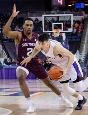 Evansville's Artur Labinowicz (2) drives against Southern Illinois' Karrington Davis (2) during their game at Ford Center Wednesday night, Feb. 5, 2020.