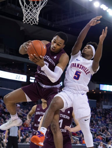 Southern Illinois' Karrington Davis (2) pulls down a rebound in front of Evansville's Shamar Givance (5) during their game at Ford Center Wednesday night, Feb. 5, 2020.