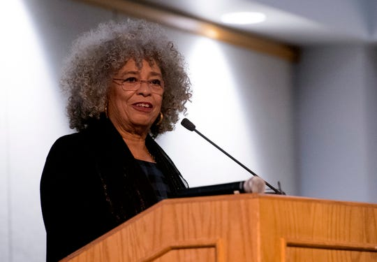 Social activist Dr. Angela Davis delivers a keynote address a crowd gathered in Carter Hall at the University of Southern Indiana during USI's Mandela Social Justice Day event Wednesday evening, Feb. 5, 2020.