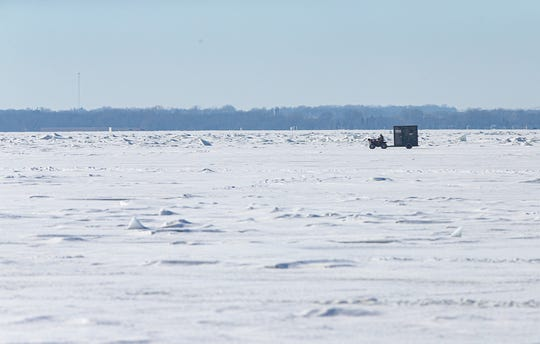 A driver on an ATV tows an ice shanty Thursday, February 6, 2020 out onto Lake Winnebago from the Fisherman's Road boat landing on the east side of the lake. Warm weather has kept the ice too thin for cars or trucks. Doug Raflik/USA TODAY NETWORK-Wisconsin
