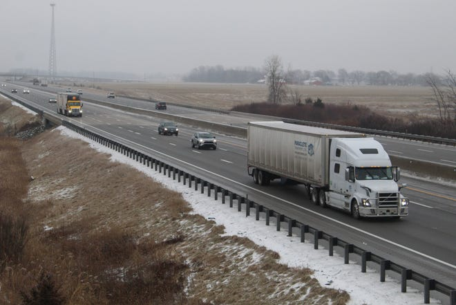 Icy roads slowed traffic along the Ohio Turnpike on Thursday. Several schools in Sandusky County canceled classes due to inclement weather.