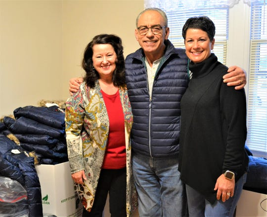 Susian Perry, left, has won the devotion of about 40 volunteers who help her with Susie's Coats. Here, she stands with two of them: former Woodville mayor Rich Harman and Susie's Coats board member Amy Blausey.