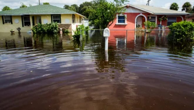 Flooding innundated Pawley Street in Bonita Springs, several blocks from the Imperial River   less than two weeks before Hurricane Irma ripped through Southwest Florida. The hurricane made the flooding even worse, prompting wide-ranging efforts to control flooding in the future.