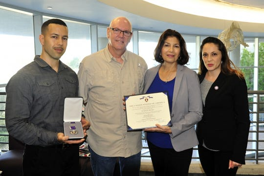 The family of one-time Lehigh Acres resident Arturo Antonsanti with the Purple Heart award he was awarded posthumously by the U.S. Coast Guard recently. From left, Nelson Antonsanti, David and Anabel Antonsanti-Weis, and daughter-in-law Daisy Antonsanti. Antonsanti was one of 28 sailors from the 199 onboard the USS Leopold in March 1944 who survived a U-boat attack in World War II. He died in 2008, years after retiring to Lehigh Acres from Long Island.