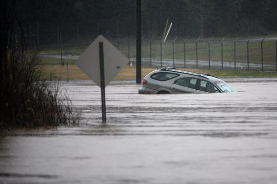 A car overtaken by flood waters on Bates Bridge Road near Travelers Rest on Thursday, Feb. 6, 2020.