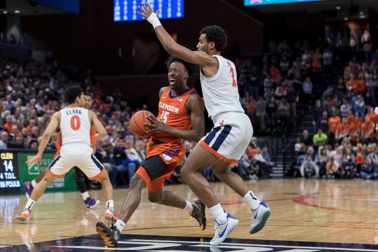 Clemson Tigers guard John Newman III (15) goes to the basket against Virginia Cavaliers guard Braxton Key (2) during the first half at John Paul Jones Arena Wednesday night in Charlottesville, Va..